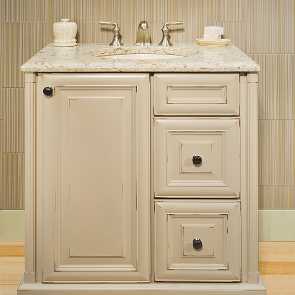 Distressed off-white bathroom cabinets and drawers