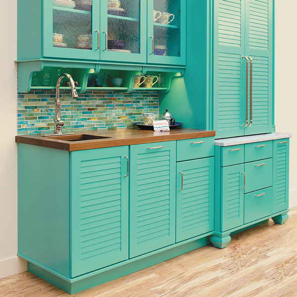 Bright teal shutter and glass cabinets