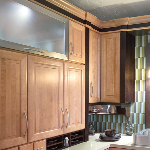 Dark wooden cabinets with light wooden doors